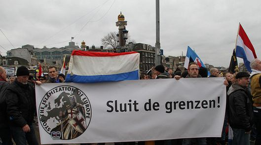 Banner on Pegida demonstration in Amsterdam, yet determined date